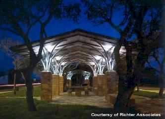 The tree-like roofing structure of a picnic arbor seems to rhyme with the existing live oak trees