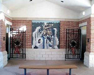 Ceramic mosaic of an Alabama-Coushatta Indian hoop dancer