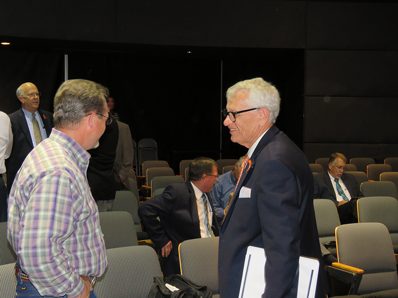 Chairman Tryon Lewis listens to an attendee.