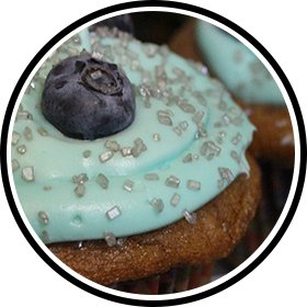 Large blueberry on a cupcake