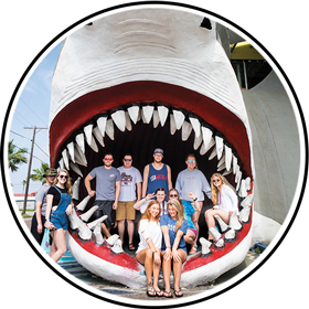 Visitors pose by the shark head at Destination Beach and Surf in Port Aransas