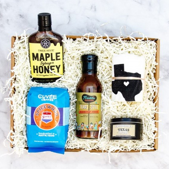 Batch box features maple syrup, bbq sauce, coffee, a candle and Texas dishtowel