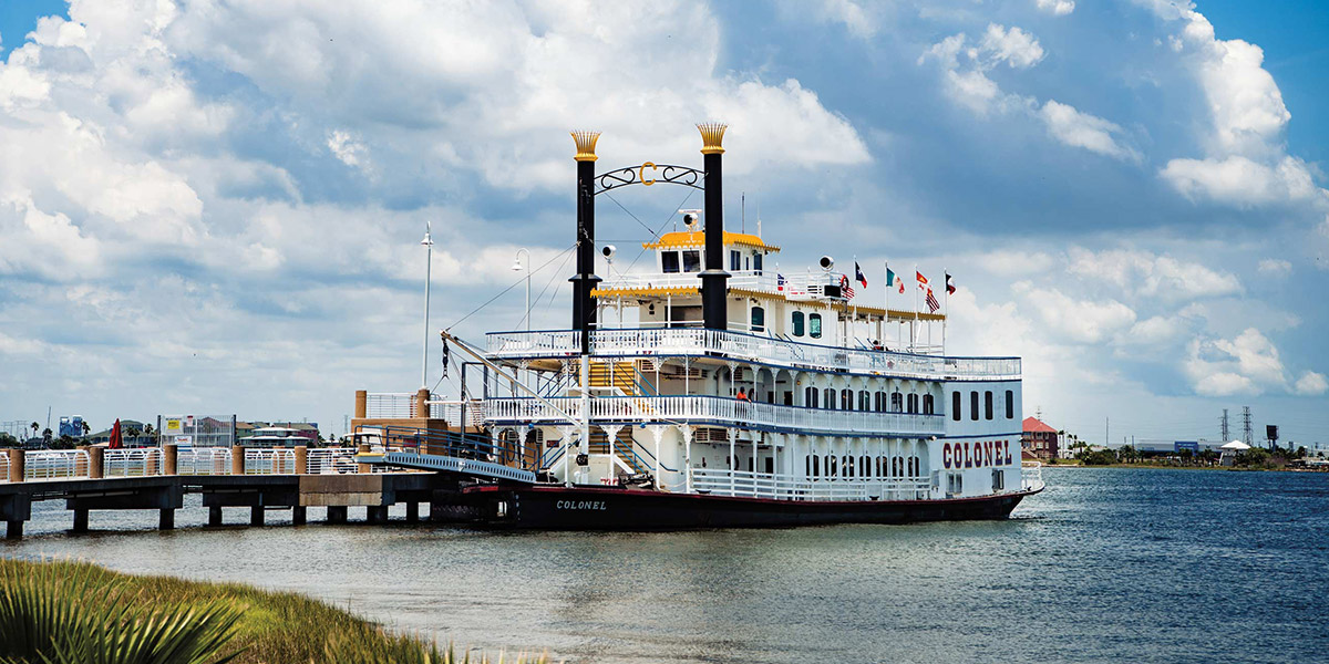 The Colonel Paddlewheel boat on the water in Galveston