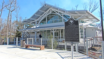View of front building entrance, with historical marker sign (eastbound only)
