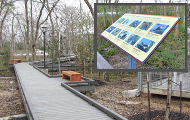 The facility features elevated walkways with interpretive displays