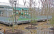View of a playground nested among new and existing trees