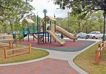View of playground area nested among the existing trees