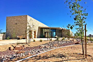 View of the new Pecos County Safety Rest Area from a landscaped dry creek