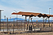 View of a picnic arbor with folded roof that mimics silhouette of distance mountains